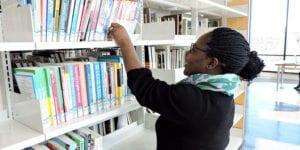 Trina Wade selecting books