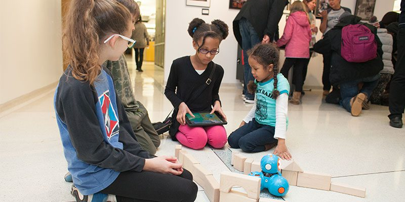 Kids playing with coding toys