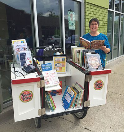 Book Bike outside Happy Apple Pie Shop with Owner Michelle Mascaro