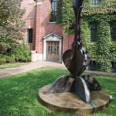 Oak Park Public Library Dole-Branch Library exterior featuring Scott Wallace's statue titled Keepsake