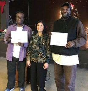 Adult Education and Job Seekers Librarian Rashmi Swain poses with two recent graduates of Housing Forward's Career Passport program.
