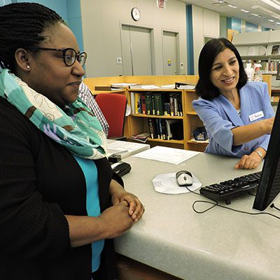 Adult Education and Job Seekers Librarian Rashmi Swain suggests a resource to Trina Wade.