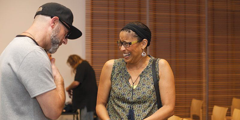 Kevin Coval and Jackie Moore talk after Coval's One Book, One Oak Park appearance