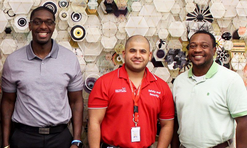Social Services Specialist Stephen Jackson, Supervisor of Safety and Security Aaron Alonzo, and Social Services Director Robert Simmons