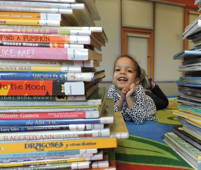 Stacks of books and child