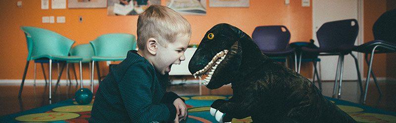 Little boy with dinosaur
