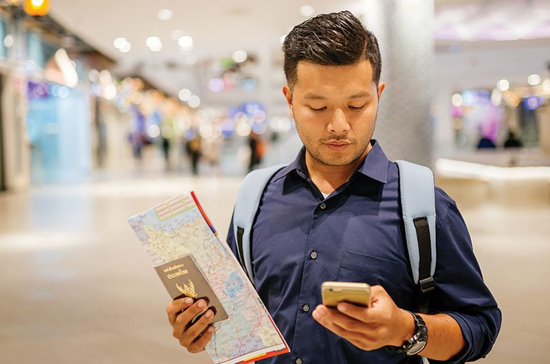 Man holding map and cellphone
