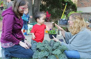 Adults and kids gardening at Maze Branch