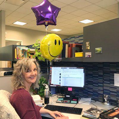 Debbie Rafine at her desk