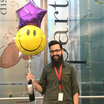 John holding balloons