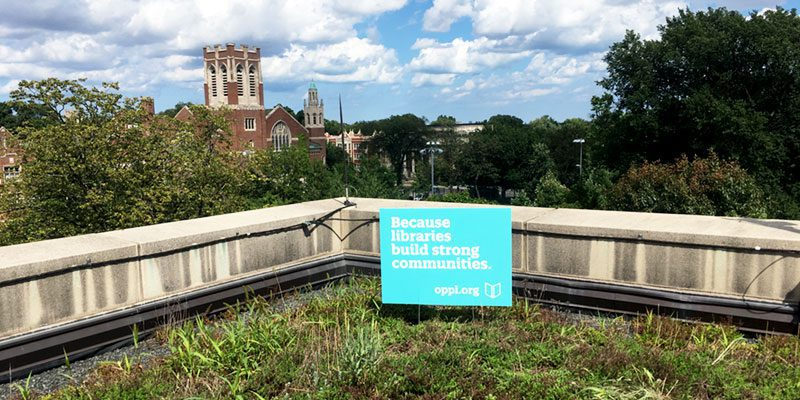 Library lawn sign on green roof: Libraries build strong communities