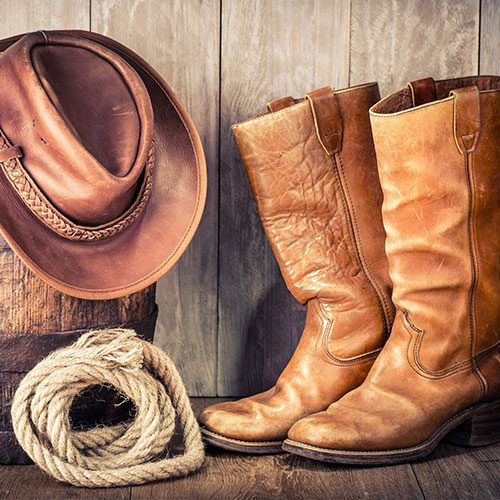 Western boots, rope, and hat
