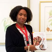 Librarian Juanita Harrell with healthy cookbook