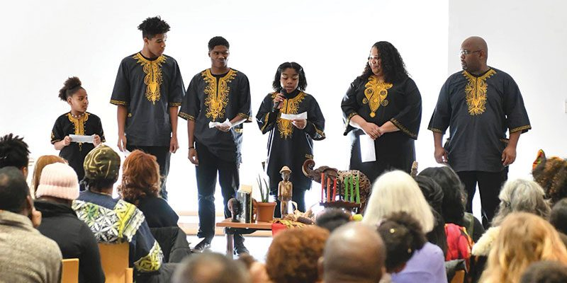 Community members celebrating Kwanzaa in the Main Library Veterans Room 2018
