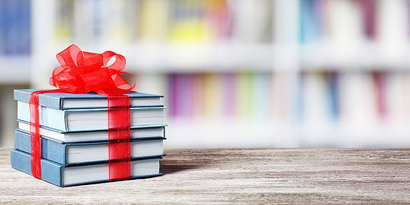 Books wrapped with a bow