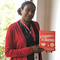 Juanita holding Happiness Is Baking