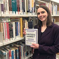 Manager Kathleen Spale with Writers Market book
