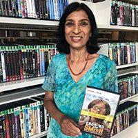 Rashmi holding Growing Up Smith