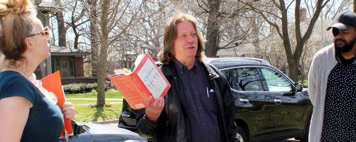 Jim Madigan leading a book discussion outside in Oak Park