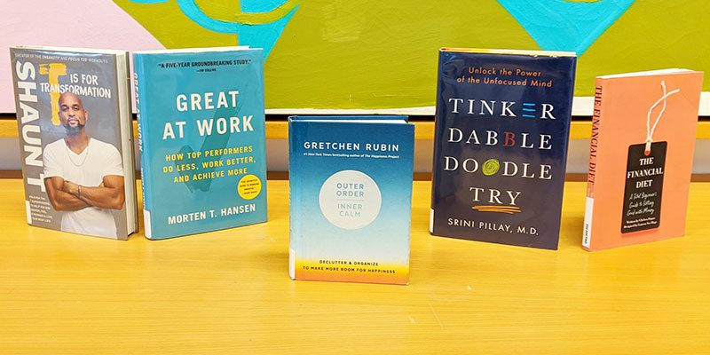 Book covers for T is for Transformation by Shaun T; Great at Work: How Top Performers Do Less, Work Better, and Achieve More by Morten T. Hansen; Outer Order, Inner Calm: Declutter and Organize to Make More Room for Happiness by Gretchen Rubin; Tinker, Dabble, Doodle, Try by Srini Pillay, M.D.; and The Financial Diet: A Total Beginner's Guide to Getting Good With Money by Chelsea Fagan
