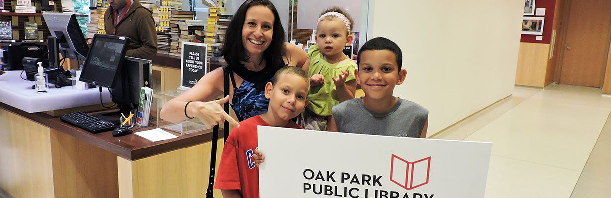 Family holding library card