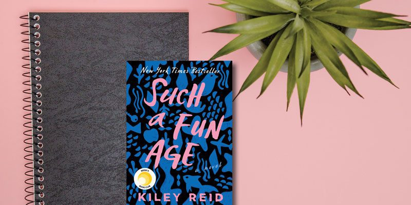 Such a Fun Age book on table with plant and notebook