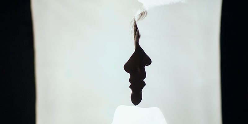 Two faces overlapping