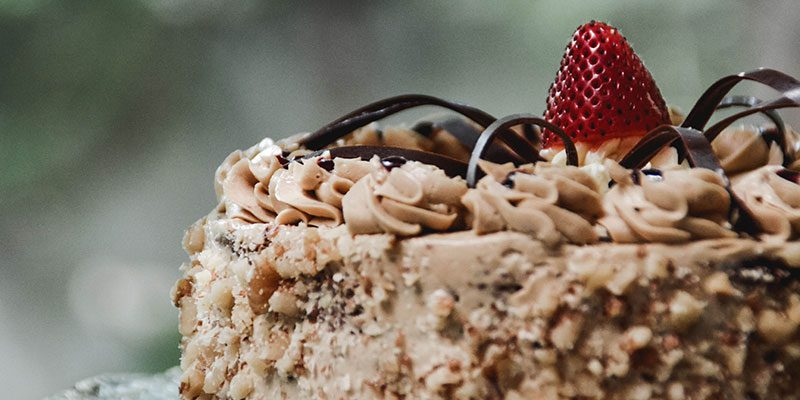 Cake decorated with chocolate and a strawberry