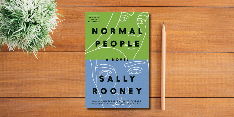 Sally Rooney on table with plant and pencil