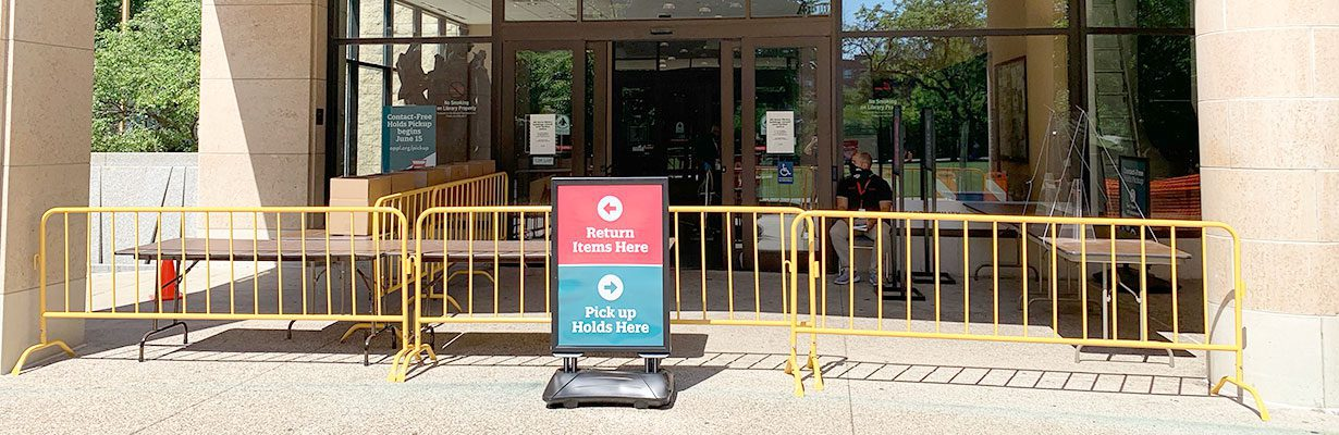 Main Library main entrance with holds pickup & returns sign