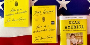 Three versions of Dear America (Spanish, English, Young Readers Edition) on American flag