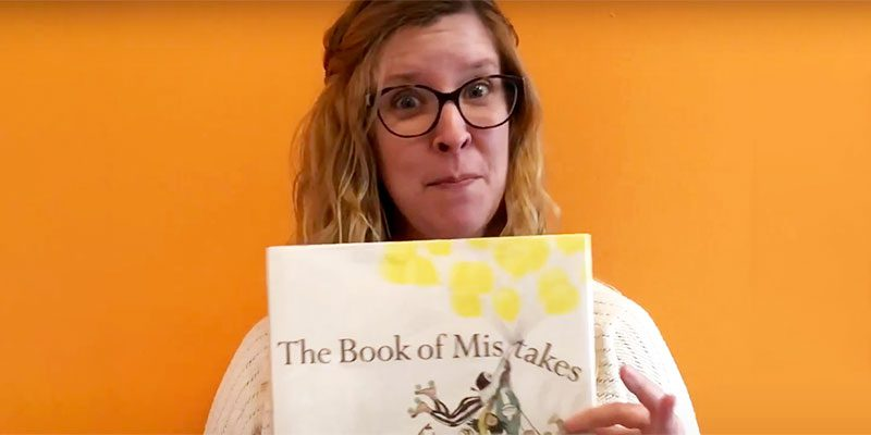 Miss Jenny holding a book