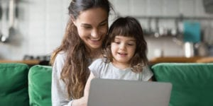 Parent and child with computer