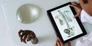 Kid looking at anatomy on tablet