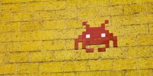 Pixel alien on wall