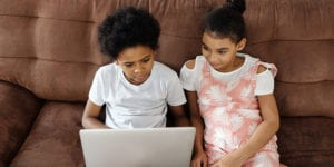 Two kids on laptop