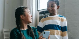 Two kids with cell phone
