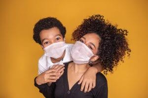 Child and women wearing masks