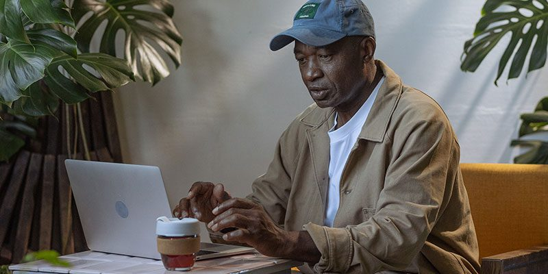 Person using a laptop outside