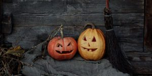 Two jack-o-lanterns with broom